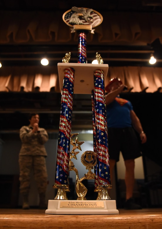 A trophy sits on display during the 81st MDG Push-up Competition at the Keesler Medical Center Don Wylie Auditorium Nov. 1, 2016, on Keesler Air Force Base, Miss. Seven five-person teams competed in the event pushing out a total of 6,272 push-ups. The 81st Dental Squadron was this year's winner with 1,127 push-ups. The Airmen who participated in the event raised money to support the Krewe of Medics Mardi Gras Ball. (U.S. Air Force photo by Kemberly Groue/Released)