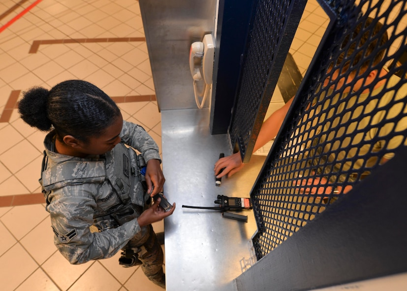 Airman 1st Class John Stumpf, an armorer assigned to the 28th Security Forces Squadron, equips Airman 1st Class Tkeyah Charley, a response force member assigned to the 28th SFS, with equipment at the armory at Ellsworth AFB, S.D., Oct. 25, 2016. Security forces Airmen have multiple levels of force available for daily use including the M4 carbine rifle, M9 pistol, batons and less-than-lethal weapons. (U.S. Air Force photo by Airman 1st Class Donald Knechtel)