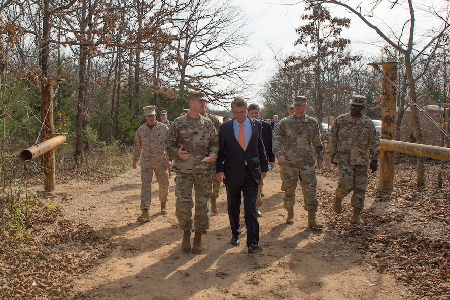 Defense Secretary Ash Carter walks with Army Maj. Gen. Kent D. Savre before a demonstration of the construction of demolition charges at Fort Leonard Wood.