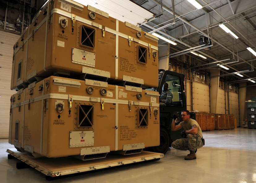 Staff Sgt. Joel Miller, 27th Special Operations Logistics Readiness Squadron Materiel Management flight Mobility Readiness Spare Package supervisor, directs Senior Airman Lawrence Wright 27th SOLRS Materiel Management flight MRSP journeyman, as he palletizes parts at Cannon Air Force Base, N.M., October 19, 2016. MRSPs contain spare parts for aircraft and are used to support designated weapons systems for as many as 30 consecutive days downrange. (U.S. Air Force photo/Staff Sgt. Whitney Amstutz/released)