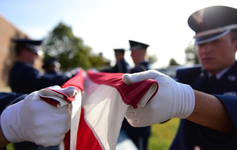"Members of the Whiteman Air Force Base Honor Guard hold an American flag at the ""canoe"" position during a simulated funeral at Whiteman Air Force Base, Mo., Nov. 2, 2016. Made up of members from different units throughout the base, the Whiteman Honor Guard performs funeral and military honors in support of 99 counties in Missouri and 19 counties in Kansas, covering more than 70,000 square miles, one of the biggest areas of responsibility in all of Air Force Global Strike Command. (U.S. Air Force photo by Senior Airman Joel Pfiester)"