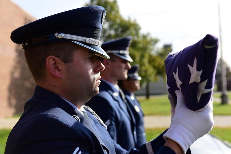 U.S. Air Force Senior Airman Jeffrey Pipkin, an A-team member of the Whiteman Air Force Base Honor Guard dresses a flag during a simulated funeral at Whiteman Air Force Base, Mo., Nov. 2, 2016. Made up of members from different units throughout the base, the Whiteman Honor Guard performs funeral and military honors in support of 99 counties in Missouri and 19 counties in Kansas, covering more than 70,000 square miles, one of the biggest areas of responsibility in all of Air Force Global Strike Command. (U.S. Air Force photo by Senior Airman Joel Pfiester)