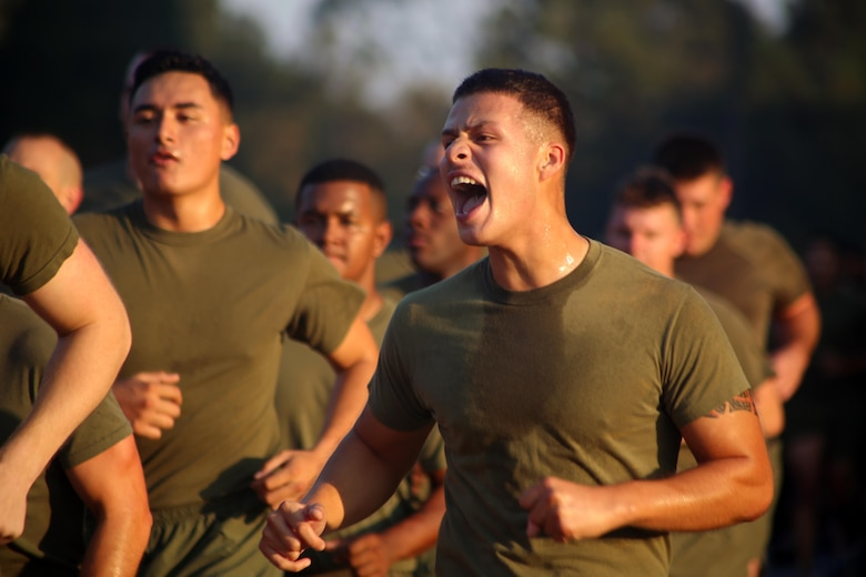 A Marine screams cadence during a Marine Corps birthday celebration run at Marine Corps Air Station Cherry Point, N.C., Nov. 3, 2016. The run celebrated the 241st Marine Corps birthday and strengthened pride, esprit de corps, and camaraderie among all Marines and Sailors aboard the air station. (U.S. Marine Corps photo by Sgt. N.W. Huertas/Released)