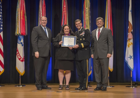 Deputy Secretary of Defense Bob Work awards Elaine McCusker, U.S. Central Command, the Department of Defense Distinguished Civilian Service Award during the 61st Annual DOD Distinguished Civilian Service Awards Nov. 3, 2016, at the Pentagon in Washington, D.C. (DoD photo by Air Force Tech. Sgt. Brigitte N. Brantley)