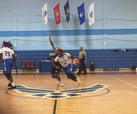 Staff Sgt. Brian Washington, an Airman dormitory leader with the 1st Special Operations Civil Engineer Squadron, passes an opponent during a basketball game. The All-Air Force Men's Basketball team is competing in the Armed Forces Tournament through Nov. 8. (Courtesy Photo)