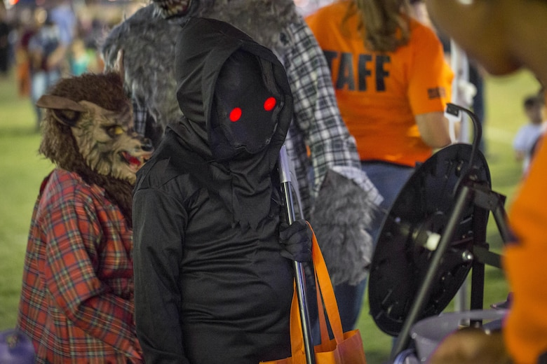 Combat Center children trick-or-treat and enjoy carnival games at the Jack-O-Lantern Jubilee hosted by Marine Corps Community Services at Del Valle Field aboard the Marine Corps Air Ground Combat Center, Twentynine Palms, Calif., Oct. 28, 2016. (Official Marine Corps photo by Cpl. Levi Schultz/Released)