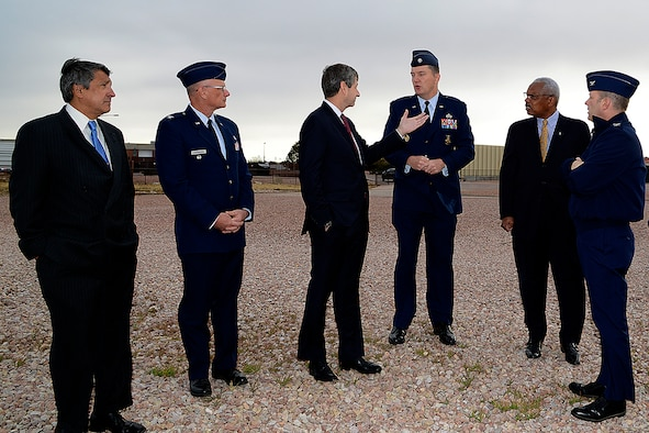 At center, Deputy Assistant Secretary of the Air Force for Environment, Safety and Infrastructure Mark Correll is briefed by Peterson Air Force Base leadership at the fire department's training facility Nov. 2, 2016. Correll and his team were visiting Peterson to discuss perfluorinated compounds contamination issue in the Fountain, Security and Widefield communities' water supply aquifer.  (U.S. Air Force photo/Rob Bussard)