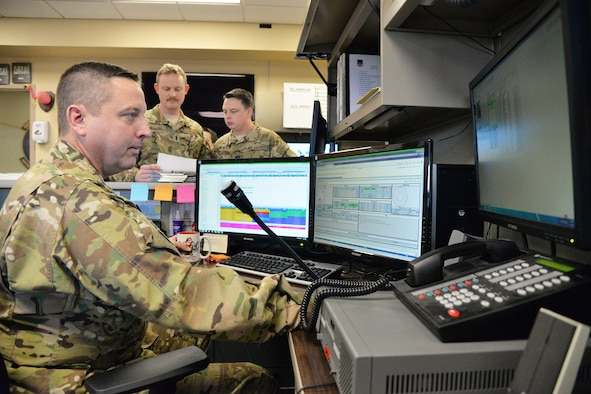 Lt. Col. Kurt Geisen, 40th Helicopter Squadron assistant director of operations, monitors pertinent flying information on a computer Nov. 2, 2016, at Malmstrom Air Force Base, Mont. The 40th HS trains for search and rescue missions in addition to the security mission they support here at the 341st Missile Wing. (U.S. Air Force photo/Airman 1st Class Daniel Brosam)