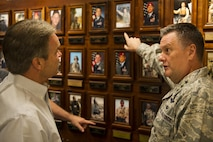 Lt. Gen. Brad Webb, commander of Air Force Special Operations Command, briefs Stacey Martin, an Air Force Chief of Staff civic leader from Clovis, N.M., on the history of the Air Force Cross and Silver Star Medal recipients at Hurlburt Field, Fla., Nov. 2, 2016. Civic leaders are unpaid advisors, key communicators and advocates for the Air Force. (U.S. Air Force photo by Airman 1st Class Joseph Pick)