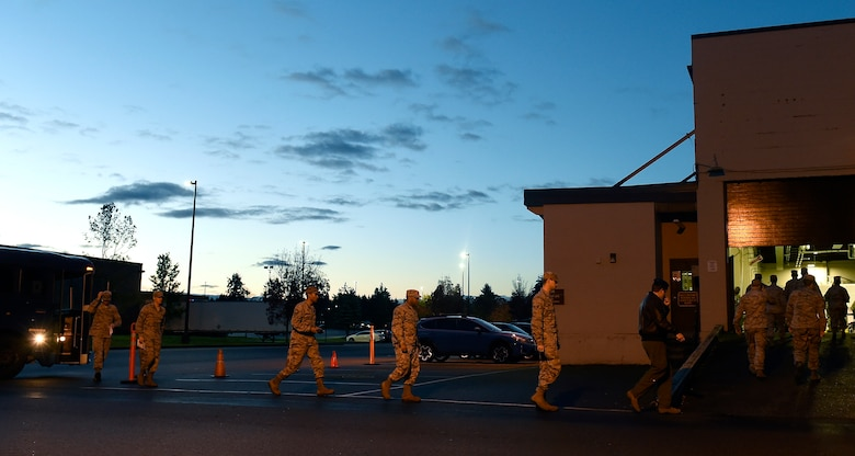 Team McChord Airmen arrive for vaccinations Oct. 28, 2016, at Joint Base Lewis-McChord, Wash.  Airmen were picked up by at their unit and bussed to one central vacation location during a point of dispensing exercise. (U.S. Air Force photo\ Tech. Sgt. Tim Chacon)