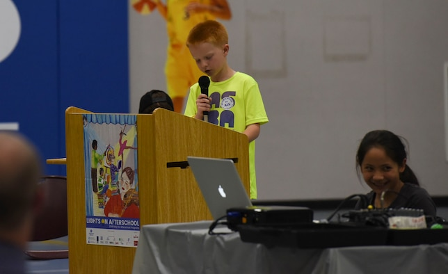 A student speaks at the Lights on Afterschool open house event, October 26, 2016 at Mountain Home Air Force Base, Idaho. The students helped make the event possible by preparing snacks, decorating the facility and making invitations. (U.S. Air Force photo by Airman 1st Class Alaysia Berry/Released)