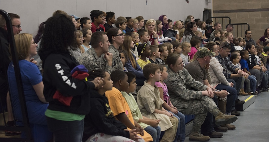 The audience watches a video at the Lights on After School open house event, October 26, 2016 at Mountain Home Air Force Base, Idaho. The video displayed various activities the children typically participate in after school. (U.S. Air Force photo by Airman 1st Class Alaysia Berry/Released)