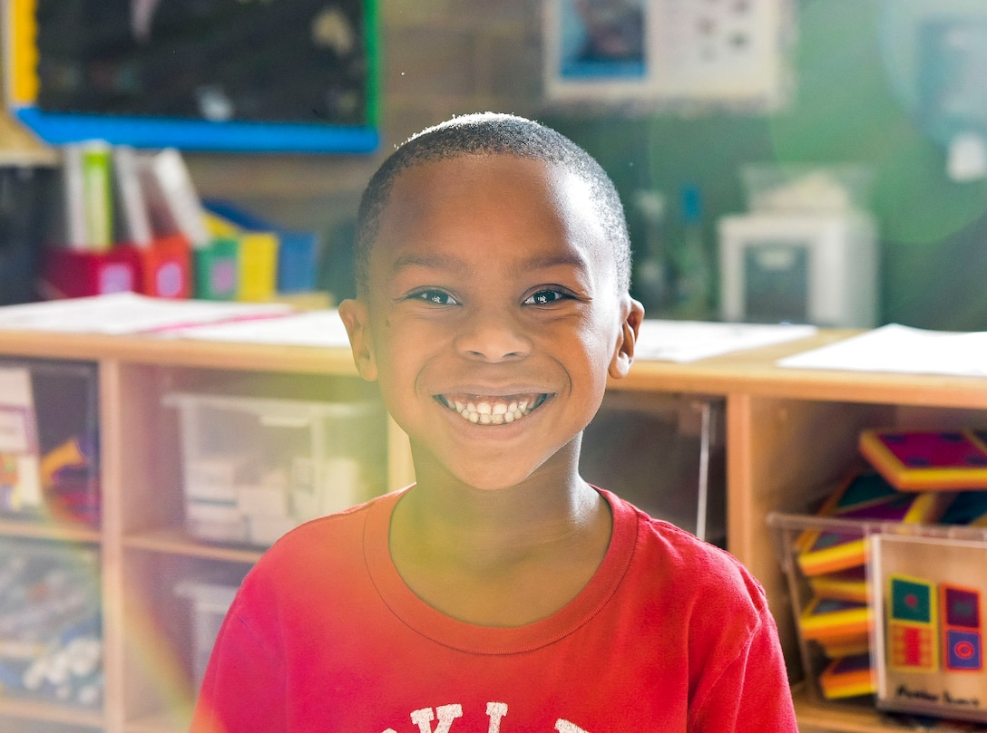 A student smiles at the camera during the Lights on After School open house event, October 26, 2016 at Mountain Home Air Force Base, Idaho. Lights on Afterschool is a project dedicated to ensuring that all children have access to quality programs.(U.S. Air Force photo by Airman 1st Class Alaysia Berry/Released)