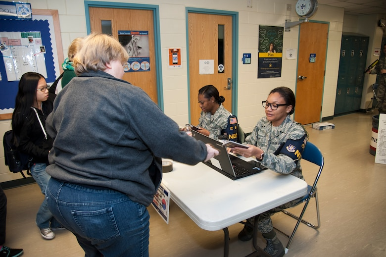 U.S. Air Force Staff Sgt. Chakara Canty, right, 25th Fighter Squadron NCO in charge of information management, and Tech. Sgt. Lashawnda Biggs, 51st Medical Support Squadron NCO in charge of Tricare operations, check in evacuating non-combatants during exercise Courageous Channel 2016 at Osan Air Base, Republic of Korea, Oct. 29, 2016. The exercise tested the non-combatant evacuation operational assembly line with families stationed on Osan and the surrounding areas. (U.S. Air Force photo by Staff Sgt. Jonathan Steffen)