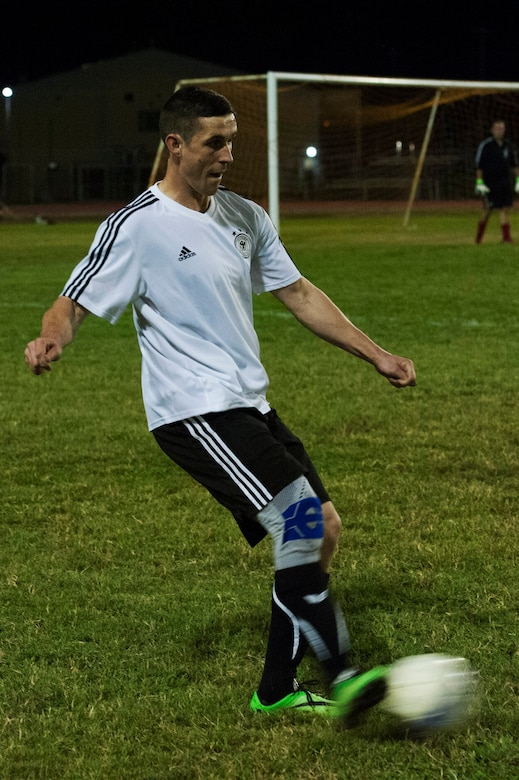 A member of the NATO intramural soccer team kicks a ball Nov. 1, 2016, at Incirlik Air Base, Turkey. The NATO team was comprised of German soldiers on the German deployment COUNTER DAESH. (U.S. Air Force photo by Airman 1st Class Devin M. Rumbaugh)