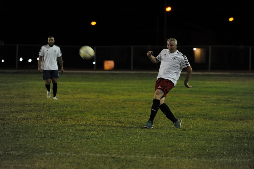 A member of the NATO intramural soccer team kicks a ball Nov. 1, 2016, at Incirlik Air Base, Turkey. The NATO team won the championship game in a five-round shootout. (U.S. Air Force photo by Airman 1st Class Devin M. Rumbaugh)