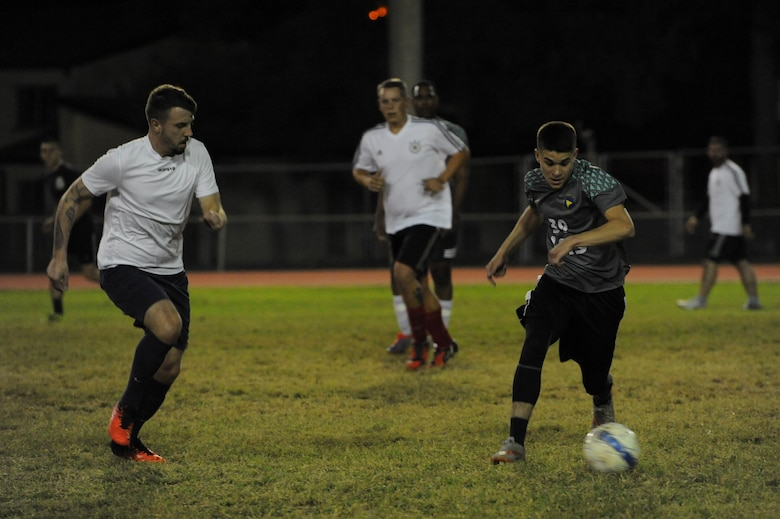 Members of the 39th LRS and NATO intramural soccer teams chase after a loose ball Nov. 1, 2016, at Incirlik Air Base, Turkey. The 39th LRS fell to NATO after a 3-5 shootout loss. (U.S. Air Force photo by Airman 1st Class Devin M. Rumbaugh)