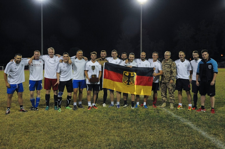 The NATO intramural soccer team stands with the championship trophy Nov. 1, 2016, at Incirlik Air Base, Turkey. The NATO team was the number one seed for the championship and won after a shootout. (U.S. Air Force photo by Airman 1st Class Devin M. Rumbaugh)