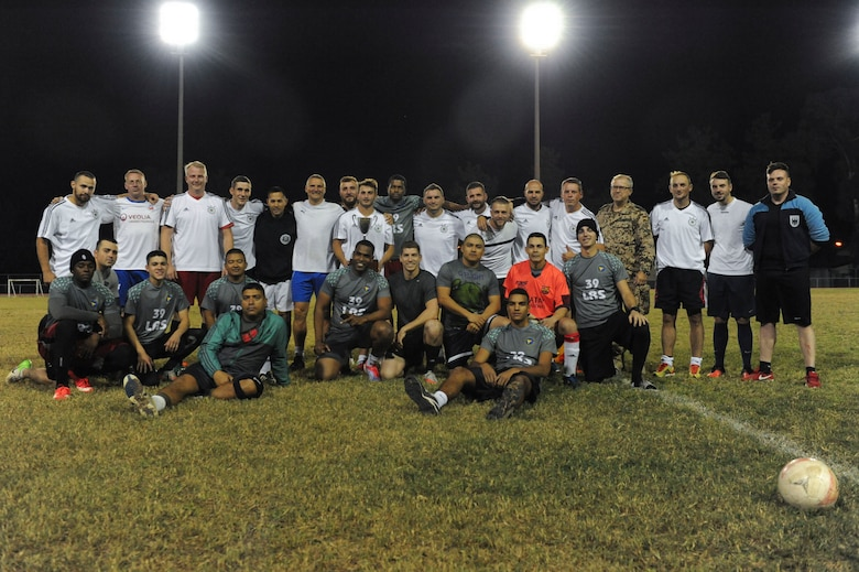 The 39th LRS and NATO intramural soccer teams pose for a photo Nov. 1, 2016, at Incirlik Air Base, Turkey. The game ended with a 5-3 shootout victory for the NATO team. (U.S. Air Force photo by Airman 1st Class Devin M. Rumbaugh)