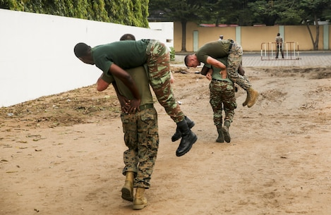Sailors with the Benin Navy conduct a physical fitness session with U.S. Marines at Benin Naval Forces Headquarters, Cotonou, Benin, October 25, 2016. The U.S. Marine Corps theater security cooperation team with Special Purpose Marine Air-Ground Task Force Crisis Response-Africa spent two weeks teaching an NCO development and maintenance management course during their time training with the Benin Navy.  (U.S. Marine Corps photo by 1st Lt. Eric Abrams /released)