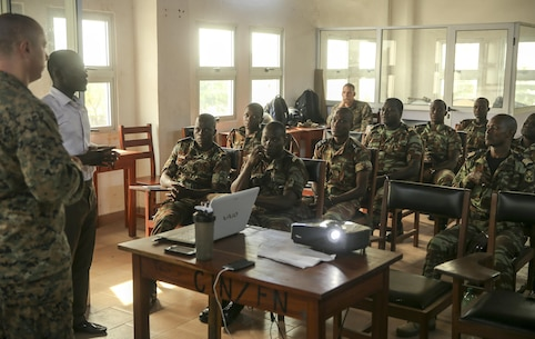 Sgt. Mateusz Kaczynski, a maintenance management chief with Special Purpose Marine Air-Ground Task Force Crisis Response-Africa, addresses a class of non-commissioned officers from the Benin Navy at Benin Naval Forces Headquarters, Cotonou, Benin, October 24, 2016. The U.S. Marine Corps theater security cooperation team with SPMAGTF-CR-AF spent two weeks teaching an NCO development and maintenance management course during their time training with the Benin Navy.  (U.S. Marine Corps photo by 1st Lt. Eric Abrams /released)