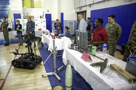 Sgt. Perry Robinson, an explosive ordnance disposal technician with Special Purpose Marine Air-Ground Task Force Crisis Response-Africa, watches a student operate the EOD Mk-II Talon robot during a career day at Naval Air Station Sigonella, Italy, Oct. 25, 2016.  EOD Marines with SPAMGTF-CR-AF went to a Department of Defense high school to display capabilities and talk to students about their job during the event.  (U. S. Marine Corps photo by Cpl. Alexander Mitchell/released)