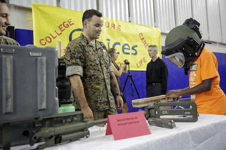 Staff Sgt. Bryce Morgan, an explosive ordnance disposal technician with Special Purpose Marine Air-Ground Task Force Crisis Response-Africa, watches a student cut wires on a simulated improvised explosive device during a career day at Naval Air Station Sigonella, Italy, Oct. 25, 2016.  EOD Marines with SPAMGTF-CR-AF went to a Department of Defense high school to display capabilities and talk to students about their job during the event.  (U. S. Marine Corps photo by Cpl. Alexander Mitchell/released)