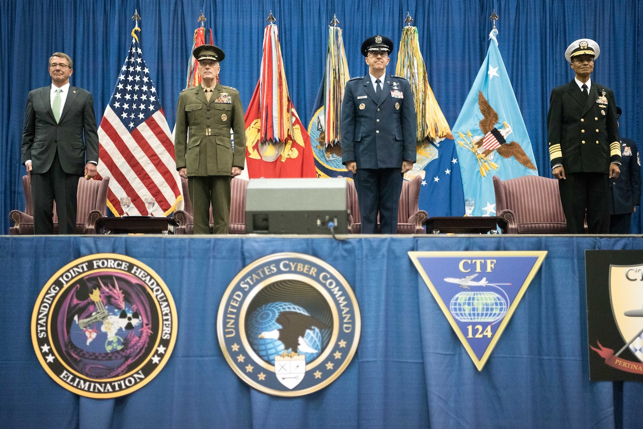 From left, Defense Secretary Ash Carter and Marine Corps Gen. Joe Dunford, chairman of the Joint Chiefs of Staff, host the U.S. Strategic Command change-of-command ceremony at Offutt Air Force Base, Neb., Nov. 3, 2016. Air Force Gen. John E. Hyten assumed command from Navy Adm. Cecil D. Haney. DoD photo by Navy Petty Officer 2nd Class Dominique A. Pineiro