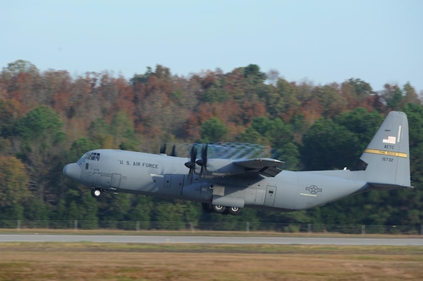 A C-130J takes off from the flightline during an 11-ship C-130J formation Oct. 24, 2016, at Little Rock Air Force Base, Ark. The aircraft is capable of operating from rough dirt-strips and is the primary transport for airdropping troops and equipment into hostile areas. (U.S. Air Force photo by Airman Grace Nichols)