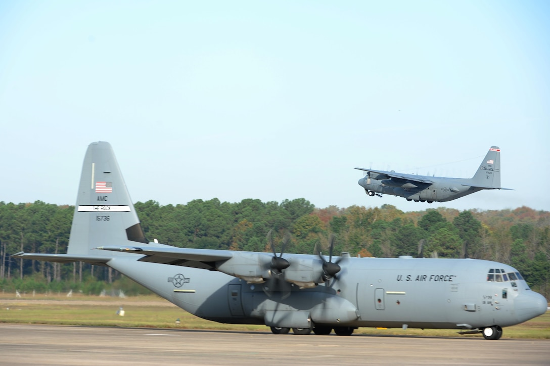 A C-130J takes off while another taxis on the flightline during an 11-ship C-130J formation Oct. 24, 2016, at Little Rock Air Force Base, Ark. The C-130J Hercules performs the tactical portion of the Combat Airlift mission. (U.S. Air Force photo by Airman Grace Nichols)