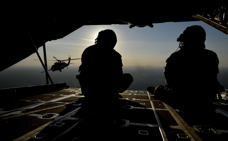 Staff Sgt. Kareem Spearman and Tech. Sgt. Jaime Bustamante, both 102nd Rescue Squadron loadmasters, watch as a UH-60 Pave Hawk refuels during an air refueling training scenario over the Gulf Coast of Mississippi during exercise Southern Strike 17, Oct. 31, 2016. Southern Strike is a total force, multi-service training exercise hosted by the Mississippi Air National Guard's Combat Readiness Training Center in Gulfport, Miss., and took place from from Oct. 24 through Nov. 4. The exercise emphasized air-to-air, air-to-ground and special operations forces training opportunities. (U.S. Air Force photo/Staff Sgt. Michael Battles)