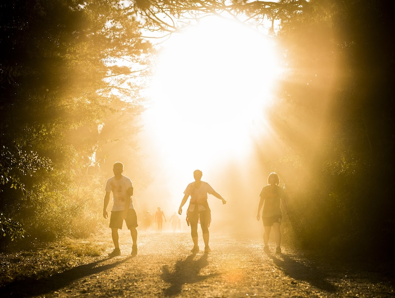 Zombies emerge from the forest as the sun begins to set at the annual Zombie Stomp run Oct. 29 at Eglin Air Force Base, Fla.  More than 100 runners participated in ducking, dodging and evading hungry zombies over the 5k course near Base Tango.  (U.S. Air Force photo/Samuel King Jr.)