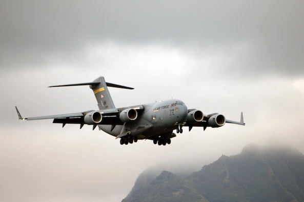 A C-17 Globemaster III assigned to the 535th Airlift Squadron, 15th Wing, glides past Waianae Range as it prepares to land at Wheeler Army Airfield, Hawaii, on Oct. 24, 2016. The C-17 made a rare landing at Wheeler AAF to pick up Soldiers from the 3rd Brigade Combat Team, 25th Infantry Division to transport them to the island of Hawaii in preparation for Lightning Forge 17. (U.S. Army photo by Staff Sgt. Armando R. Limon, 3rd Brigade Combat Team, 25th Infantry Division)