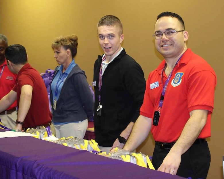 Tech Sgt. Ray Wahl (left) and Master Sgt. Clay Jennings help register participants at an Air Force Reserve Yellow Ribbon Reintegration Program training event Dec. 18, 2015, in Florida. Wahl is a Yellow Ribbon representative with the 931st Air Refueling Group at McConnell Air Force Base,  Kansas, while Jennings fills the same role for the 301st Fighter Wing at Naval Air Station Forth Worth Joint Reserve Base, Texas.(U.S. Air Force photo by Staff Sgt. Jaimi Upthegrove)