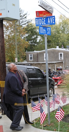 Pet Coleman (left) and Denny Coleman, brothers of the guest of honor, unveil the new street sign to Ronald S. Coleman Boulevard Oct. 22, 2016, in Darby, Pa. Retired U.S. Marine Corps Lt. Gen. Ronald S. Coleman was being honored as a hometown hero during a street dedication ceremony. (U.S. Marine Corps photo by Cpl. Matthew Myers)
