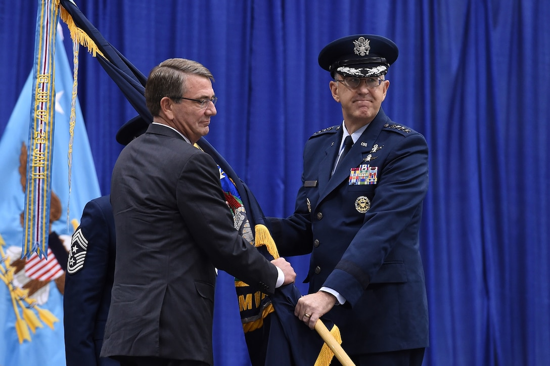 Gen. John E. Hyten (right), accepts the command guidon from Secretary of Defense Ash Carter as he assumes command of U.S. Strategic Command (USSTRATCOM) during a change of command ceremony at Offutt Air Force Base, Neb., Nov. 3, 2016. Carter presided over the change of command and provided remarks during which he congratulated Hyten on his appointment as the new USSTRATCOM commander. He also thanked Adm. Cecil D. Haney, outgoing USSTRATCOM commander, for his service. Additionally, Chairman of the Joint Chiefs of Staff Gen. Joseph F. Dunford provided remarks during the ceremony and presented the Joint Meritorious Unit Award to USSTRATCOM. Hyten previously served as commander of Air Force Space Command, and Haney will retire from active military duty during a separate ceremony in January. One of nine DoD unified combatant commands, USSTRATCOM has global strategic missions assigned through the Unified Command Plan that include strategic deterrence; space operations; cyberspace operations; joint electronic warfare; global strike; missile defense; intelligence, surveillance and reconnaissance; combating weapons of mass destruction; and analysis and targeting. (U.S. Air Force photo by Staff Sgt. Jonathan Lovelady)