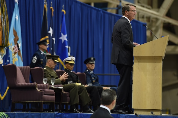 Secretary of Defense Ash Carter (right) provides remarks during the U.S. Strategic Command (USSTRATCOM) change of command ceremony at Offutt Air Force Base, Neb., Nov. 3, 2016. Carter, who presided over the change of command, congratulated Gen. John E. Hyten (seated right) on his appointment as the new USSTRATCOM commander. He also thanked Adm. Cecil D. Haney (seated center), outgoing USSTRATCOM commander, for his service. Additionally, Chairman of the Joint Chiefs of Staff Gen. Joseph F. Dunford (seated left) provided remarks during the ceremony and presented the Joint Meritorious Unit Award to USSTRATCOM. Hyten previously served as commander of Air Force Space Command, and Haney will retire from active military duty during a separate ceremony in January. One of nine DoD unified combatant commands, USSTRATCOM has global strategic missions assigned through the Unified Command Plan that include strategic deterrence; space operations; cyberspace operations; joint electronic warfare; global strike; missile defense; intelligence, surveillance and reconnaissance; combating weapons of mass destruction; and analysis and targeting. (U.S. Air Force photo by Staff Sgt. Jonathan Lovelady)
