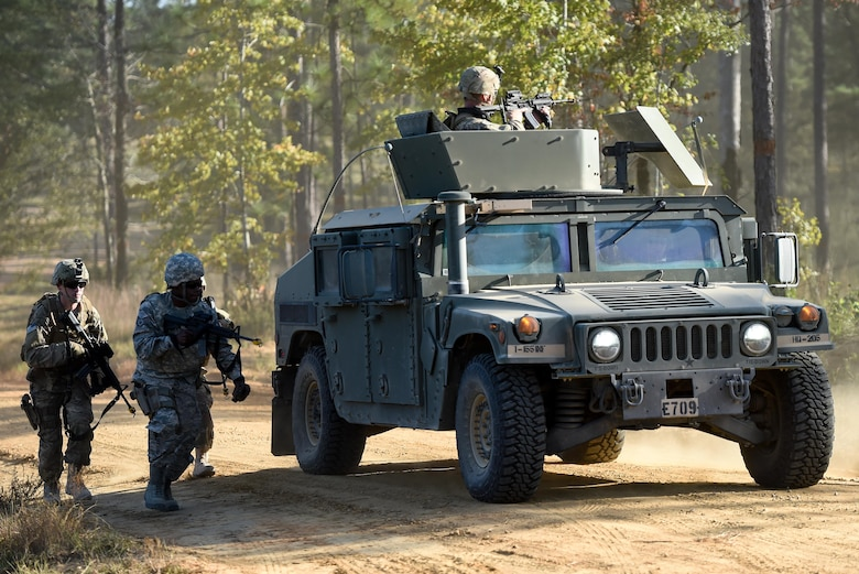 Air Commandos with the 1st Special Operations Mission Support Group take cover behind a Humvee during Task Force Exercise Southern Strike at Camp Shelby, Miss., Oct. 25, 2016. The simulated firefight lasted about 10 minutes, with the Air Commandos jumping into action to return fire.  They took cover behind their armored Humvees and slowly advanced on enemy positions to suppress their would-be assailants. (U.S. Air Force photo by Senior Airman Jeff Parkinson)