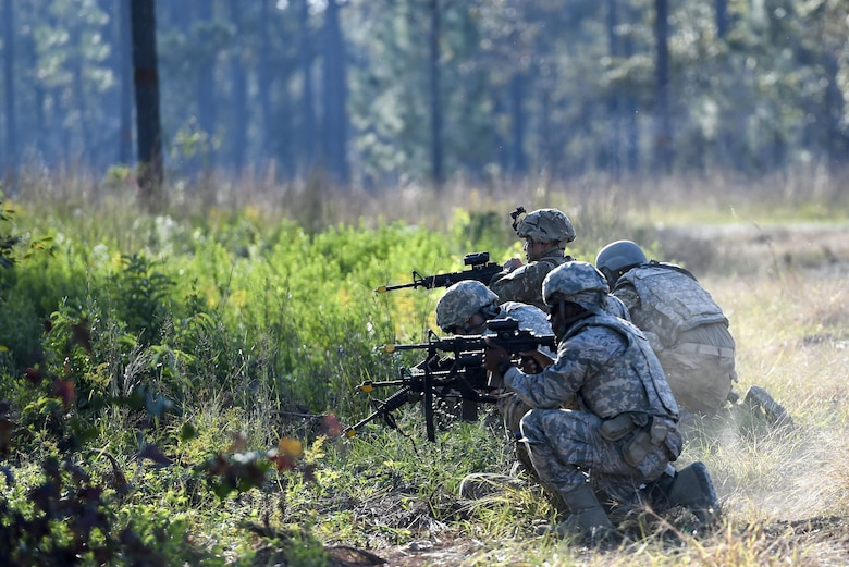 Air Commandos with the 1st Special Operations Mission Support Group simulate returning fire during Task Force Exercise Southern Strike at Camp Shelby, Miss., Oct. 25, 2016. Students were evaluated on their ability to respond to a possible IED along their route, provide security while meeting with village leaders and finally - react to enemy weapons fire during their convoy's return back to base. (U.S. Air Force photo by Senior Airman Jeff Parkinson)