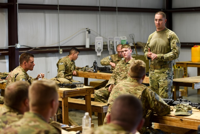 Capt. Justin May, operations officer for the 1st Special Operations Security Forces Squadron, discusses a mission in an after-action report during Task Force Exercise Southern Strike at Camp Shelby, Miss., Oct. 25, 2016. After-action reports are used to discuss areas of a mission that could be improved. (U.S. Air Force photo by Senior Airman Jeff Parkinson)