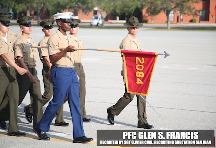 Private First Class Glen S. Francis, honor graduate of platoon 2084, holds his guidon at parade rest before graduation Nov. 4, 2016, aboard Marine Corps Recruit Depot Parris Island, South Carolina. Francis was recruited out of Recruiting Substation San Juan by Sgt. Olivier Civil. (Official Marine Corps photo by Cpl. Diamond N. Peden/Released)
