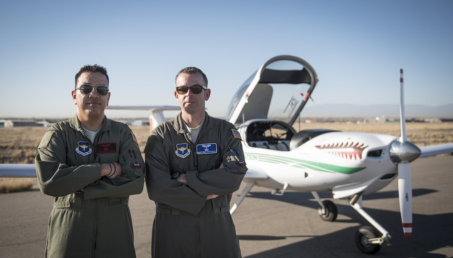 Master Sgts. Alex and Mike, 1st Flying Training Squadron Remotely Piloted Aircraft Initial Flight Training student, pose after completing an Air Force first enlisted solo flight on a Diamond DA-20 at Pueblo Memorial Airport, Pueblo, Colorado Nov. 3, 2016. Today the first enlisted pilot class students took their first solo flight instruction during the 1st FTS training. RPA IFT includes 41 hours of classroom training and 21 hours of pilot training and officer development. (U.S. Air Force digital image by Staff Sgt. Cory Payne)