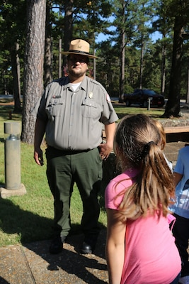 Seth Fisher, natural resource specialist with Little Rock District U.S Army Corps of Engineers conducts a school tour with a group of local children from Heber Springs, Arkansas on October 27.  Fisher is a new employee with the Little Rock District and used his passion of the outdoors for a career in natural resources. The central Arkansas native spend his childhood on his grandparents' 500 acre farm and knew during his adolescents that he would later grow up and work in nature.