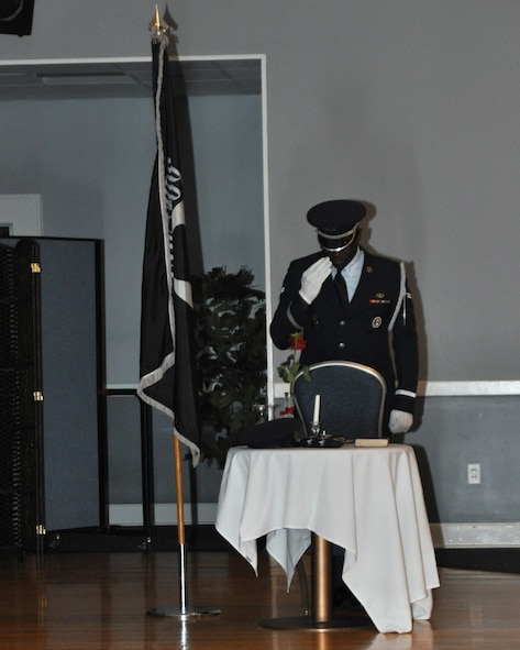 Airman 1st Class Bernard Davis, 14th Security Forces Squadron and Columbus Air Force Base Honor Guardsman, renders a salute to those missing in action and prisoners of war at the 48th Squadron's reunion Oct. 29, 2016, at the Columbus Club on Columbus AFB, Mississippi. Members of the 48th, both present and past, gathered to celebrate their heritage and to meet with one another.