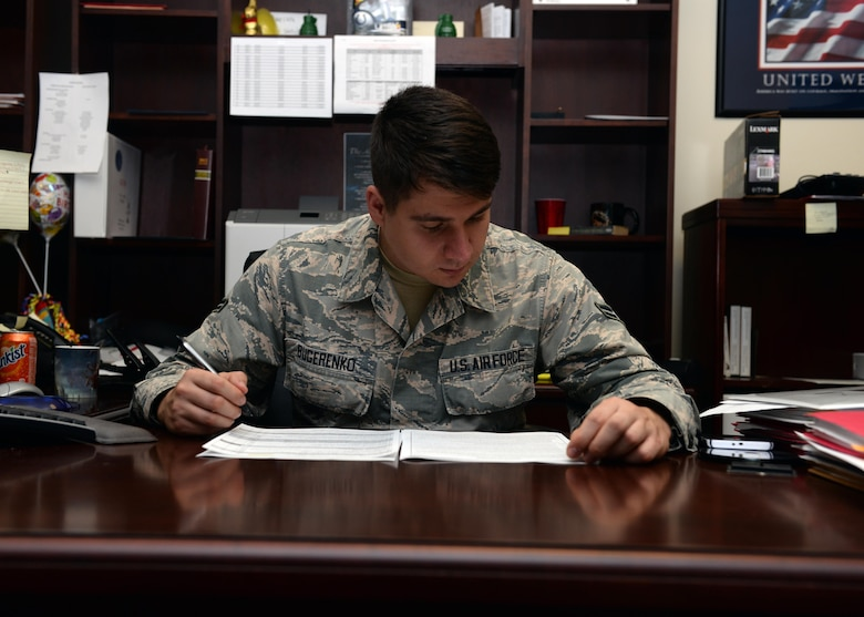 U.S. Air Force Airman First Class Alexander Bugerenko, 97th Air Mobility Wing Military Justice paralegal, simulates working on an Article 15 checklist, Nov.1, 2016, at Altus Air Force Base, Okla. The Base Legal Office helps base members with legal matters and services as well as advising commanders on legal proceedings. (U.S. Air Force Photo by Airman Jackson Haddon/ Released)