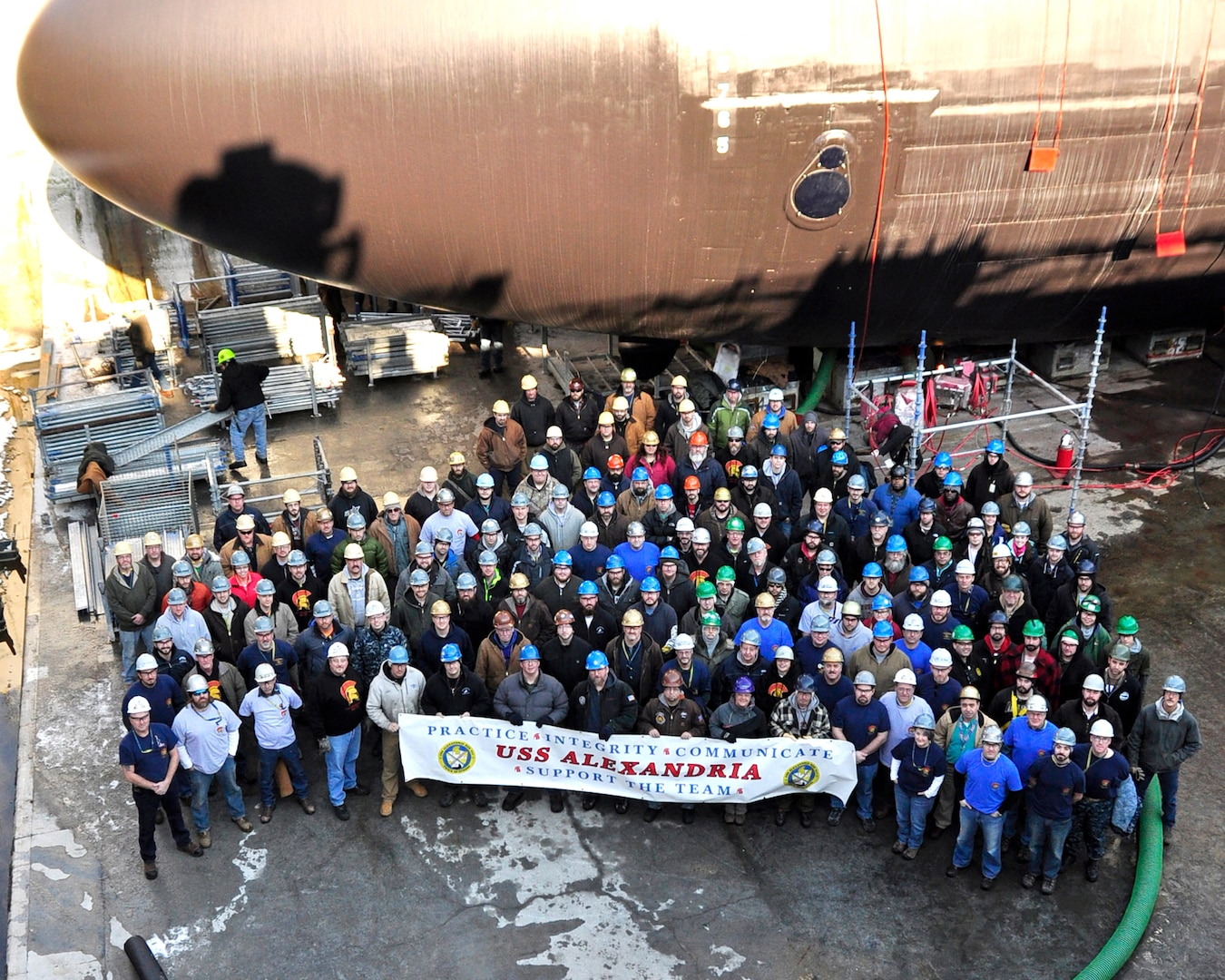 KITTERY, MAINE - Portsmouth Naval Shipyard workers gather in front of USS Alexandria (SSN 757) during its engineering overhaul, the fastest in the Navy's history.