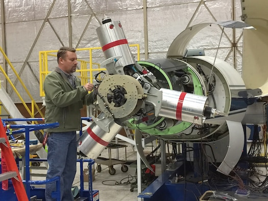 AEDC instrumentation engineer Dan Pruyn works on the Tiltrotor Test Rig in preparation for a test in the 40-foot by-80-foot wind tunnel at the National Full-Scale Aerodynamics Complex, the AEDC wind tunnel testing site located in California. The test of the TTR is a project sponsored by the National Aeronautics and Space Administration. TTR is a horizontal axis rig and rotates on the test section turntable to face the rotor into the wind at high speed, or fly edge-wise at low speed (100 knots), or at any angle in between. It is designed to accommodate a variety of rotors. (U.S. Air Force photo/Jeffrey Johnson)