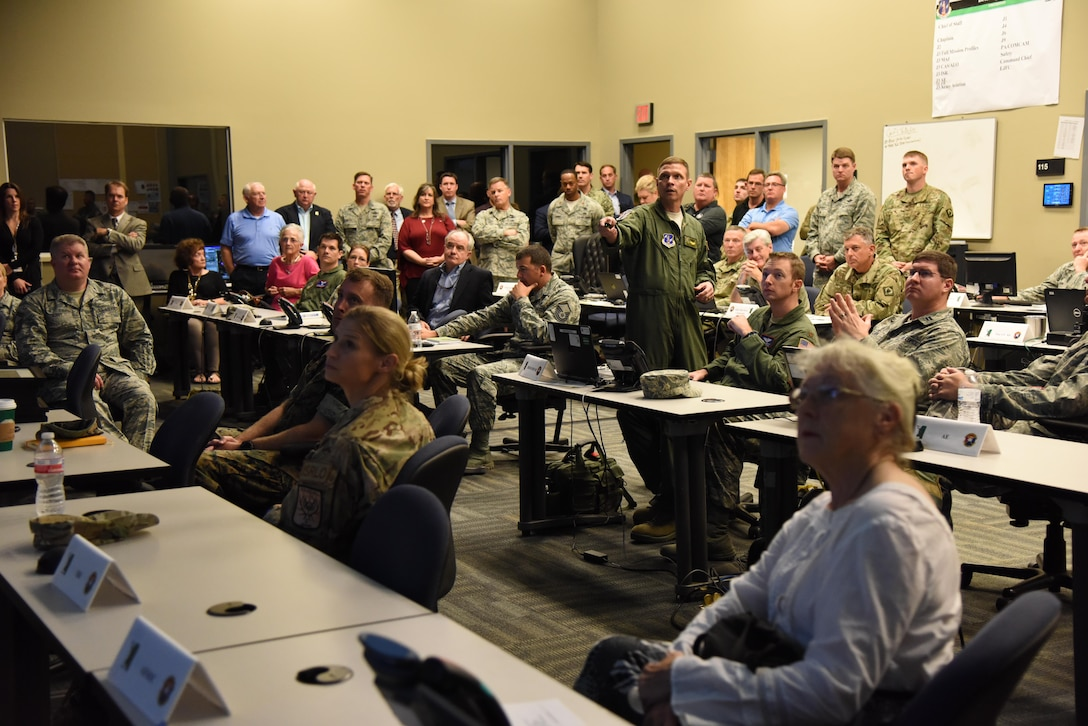 Lt. Col. Billy Murphy, Southern Strike 2017 exercise vice commander for air operations, delivers a brief during the Southern Strike Exercise Distinguished Visitor Day at the Combat Readiness Training Center, Gulfport, Miss., Nov. 3, 2016. Col. C. Mike Smith, 81st Training Wing vice commander, attended the event. Airmen from the 81st Medical Group participated Southern Strike which is a multi-service training exercise hosted by the Mississippi Air National Guard emphasizing air-to-air, air-to-ground and special operations forces training. (U.S. Air Force photo by Kemberly Groue/Released)