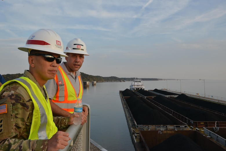 Caleb Skinner, lockmaster at Kentucky Lock explains barge traffic to Brig. Gen. Mark Toy, U.S. Army Corps of Engineers Great Lakes and Ohio River Division commander, as he tours the Kentucky Lock Addition Project in Grand Rivers, Ky., Nov. 2, 2016 as part of a command priority to meet the work force and learn first-hand the national importance of civil works projects during his visit to the Nashville District.
