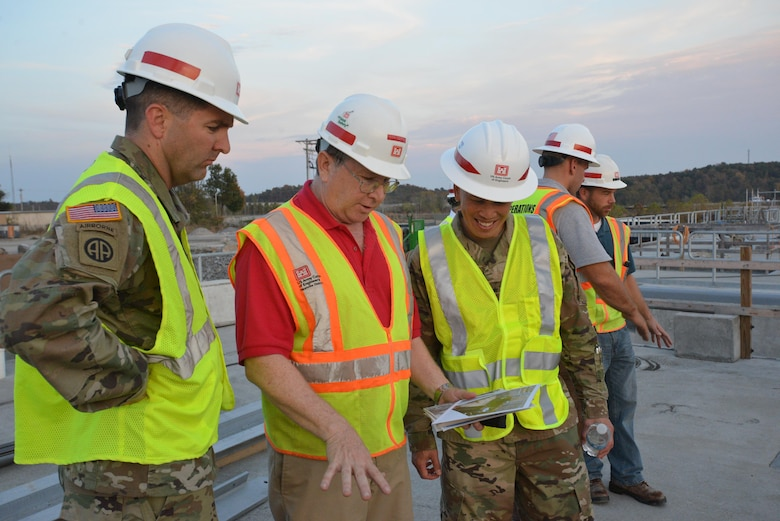 Lt. Col. Stephen Murphy, Nashville District commander listens as Don Getty, Kentucky Lock Addition Project project manager, explains construction to Brig. Gen. Mark Toy, U.S. Army Corps of Engineers Great Lakes and Ohio River Division commander, on the construction site in Grand Rivers, Ky., Nov. 2, 2016.
